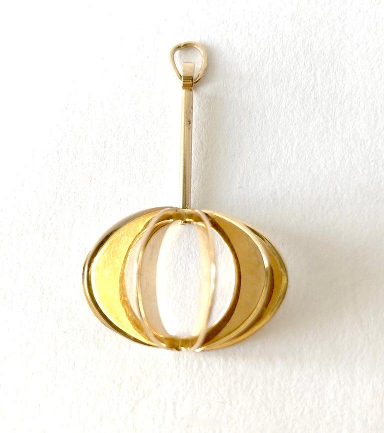 An 18 karat gold pendant designed by goldsmith Theresia Hvorslev of Stockholm, Sweden.  Pendant measures 1.5