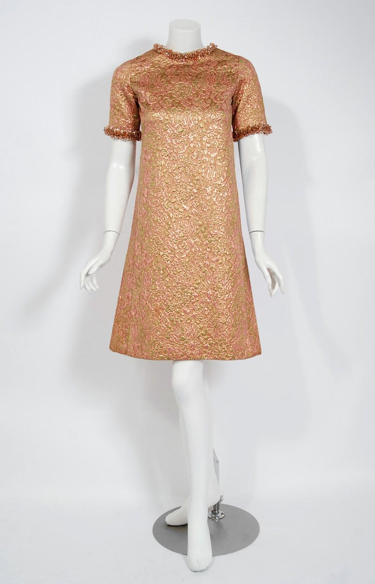 This exceptionally chic metallic silk-brocade cocktail dress is from the infamous Rive Gauche collection during Fall-Winter 1966. Pieces from this decade are very rare and are true examples of fashion history. The fabric itself is a mastepiece;