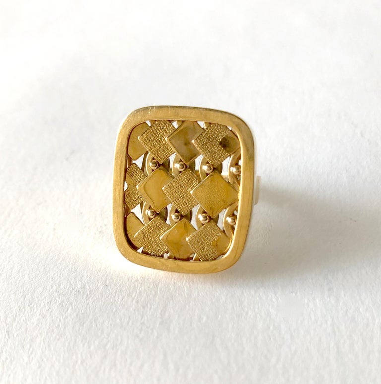 An 18 karat gold ring with textured diamond design ring created by Waldemar Jonsson of Skara, Sweden.  Ring is a finger size 6.5 and is signed 18K, Swedish Hallmarks, S9 (1968).  In very good vintage condition.  12.4 grams.