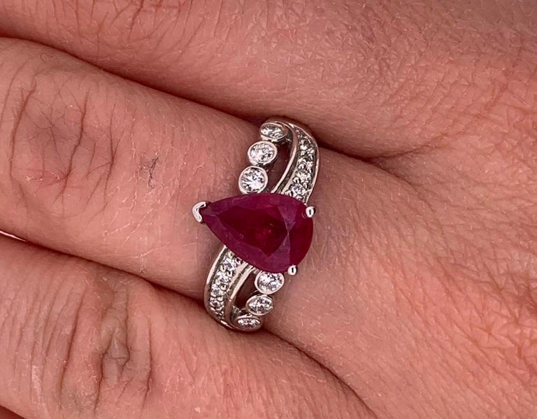 Material: 14k White Gold Gemstone Details: 1 Pear Shaped Ruby at 1.97 Carats - Measuring 9.5 x 6.5 mm Diamond Details: 16 Brilliant Round White Diamonds at 0.28 Carats. SI Clarity / H-I Color.  Ring Size: 6.5. Alberto offers complimentary sizing on