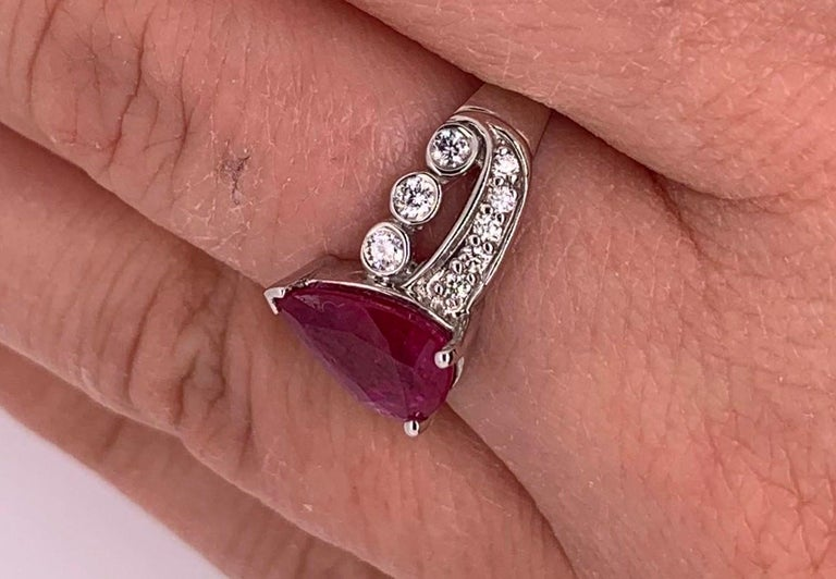 Contemporary 1.97 Carat Ruby Engagement Ring with Swirl Diamond Band For Sale