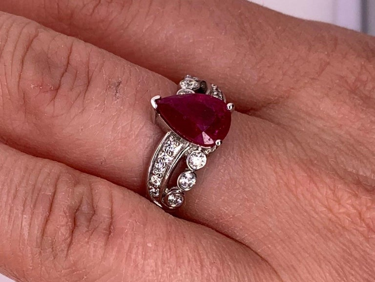 Pear Cut 1.97 Carat Ruby Engagement Ring with Swirl Diamond Band For Sale