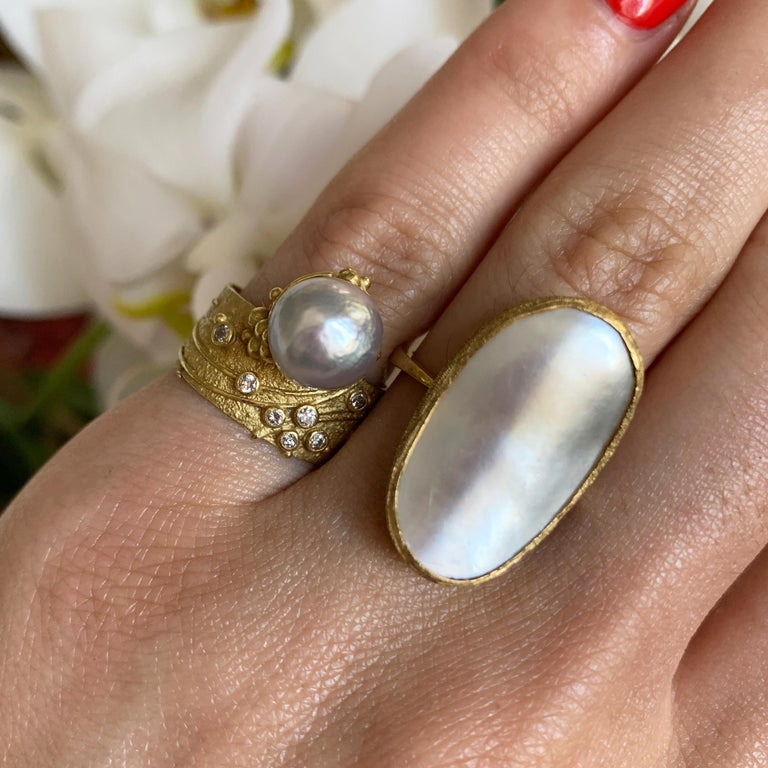 A mabe pearl and 18 karat gold ring, by renowned British jewelry designer Andrew Grima, 1970.   The ring measures size 5.75 but fits comfortably as a 6.5. It is signed Grima and stamped HJ& Co., 750. Stamped with London hallmarks dated with letter