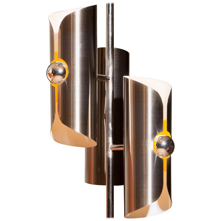 Beautiful 1970 Italian floor lamp in chrome and steel combined with a total height of 160 cm. The shades are fixed and made of brushed steel. The shades are height 28 cm. and ø 9 cm. Inside the shades are white lacquered and in the middle part is