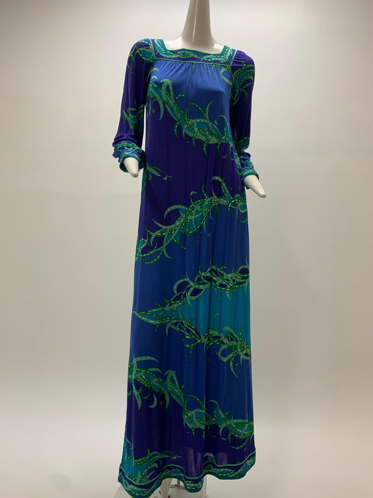 A wonderful 1970s Emilio Pucci long-sleeved silk jersey print maxi dress in purple, blue, aqua and green. Banded cuffs, hem and squared neckline. Slip-on shift style design.