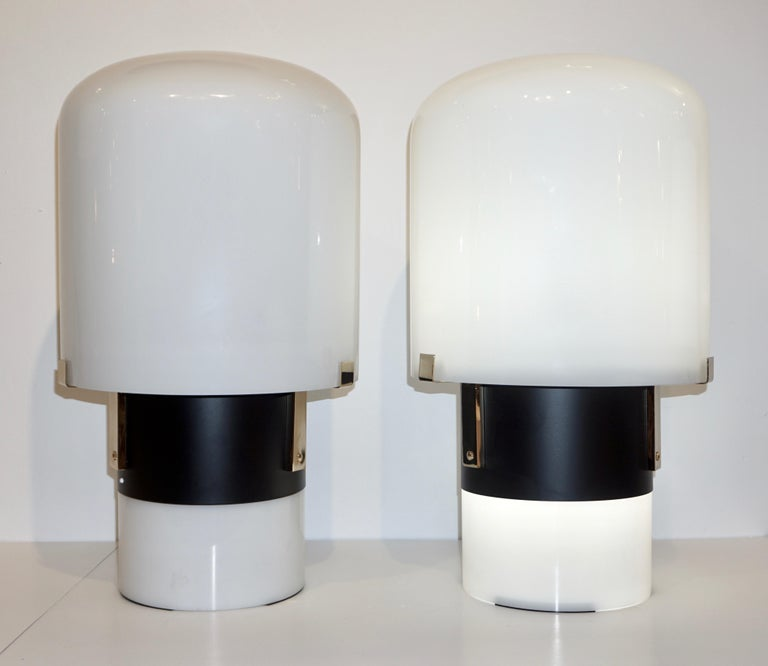 Italian architectural Pair of tall table or floor lamps of urban modern design by LOM, a lighting company in Monza (near Milan), closed in the 1990s, distinguished by the use of excellent materials and effective simple Design. The cylindrical