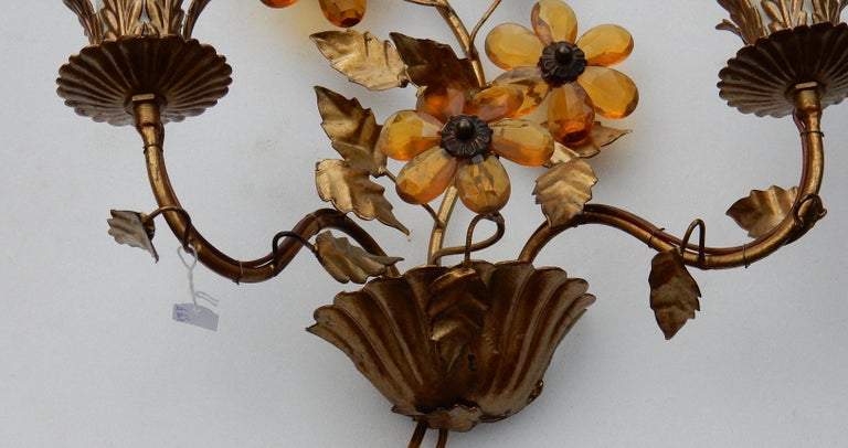 Golden metal sconces, two bulbs, flowers in glass orange color or crystal Good condition, circa 1970.