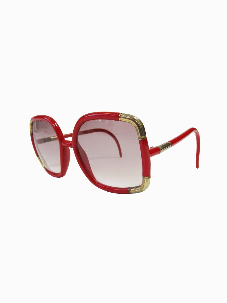 Classic Ted Lapidus Paris sunglasses in a bright red with gold accents and rose gradient lenses.  Lens Width-57mm Bridge Width- 15mm Temple (arm) Length - 5in