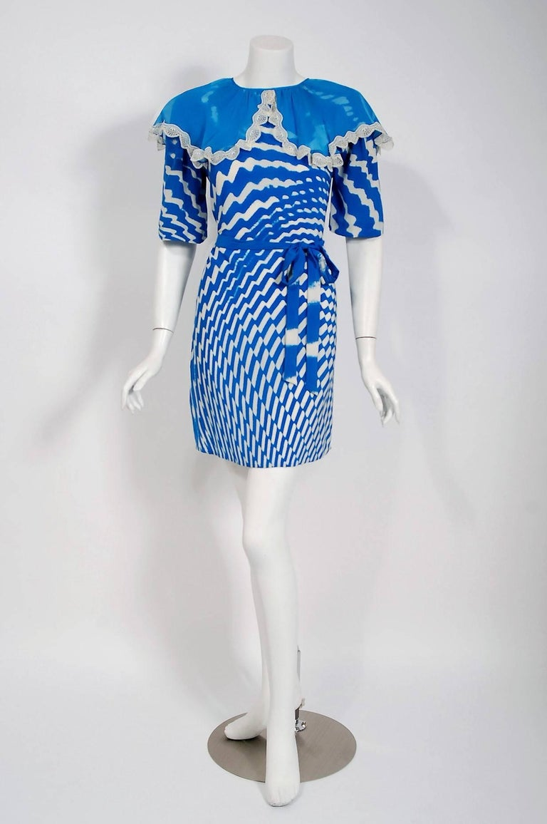 Gorgeous 1970 Thea Porter Couture tunic dress fashioned in a stunning blue and white graphic op-art print silk. I love that oversize flouncy sheer silk-chiffon lace trimmed collar. The bodice is a clear nod to 1930's fashion. The flirty mini length