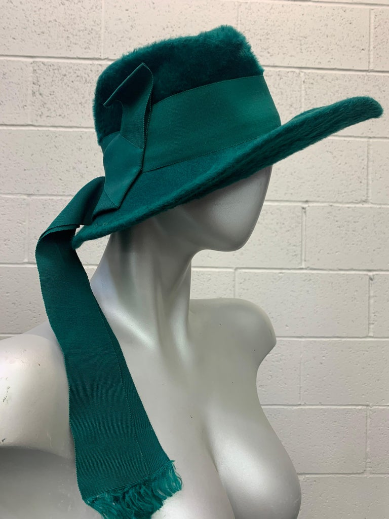 1970's ultra chic Yves Saint Laurent fur felt Fedora style hat in deep emerald green features a wide coordinating grosgrain ribbon band and ribbon streamers that trail to the back adding flair to this rare beauty .  Hat measures 22 inches and is in