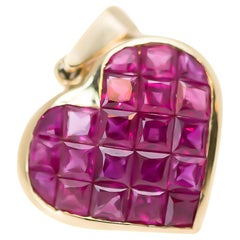 1970s 1.0 Carat Total Ruby and 14 Karat Yellow Gold Puffed Heart Pendant