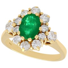 1970s 1.30 Carat Emerald and Diamond Yellow Gold Cluster Cocktail Ring