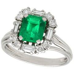 1970s 1.43 Carat Emerald and Diamond Platinum Cluster Ring