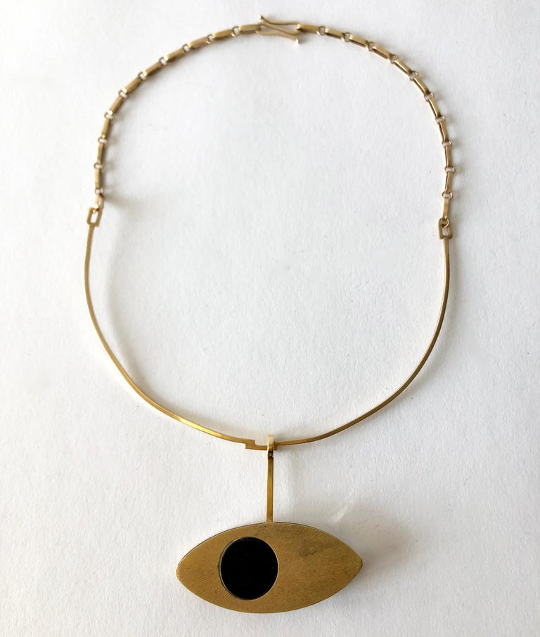 14K gold necklace with clear and black lucite eye pendant, circa 1970's. Necklace portion has 16.5