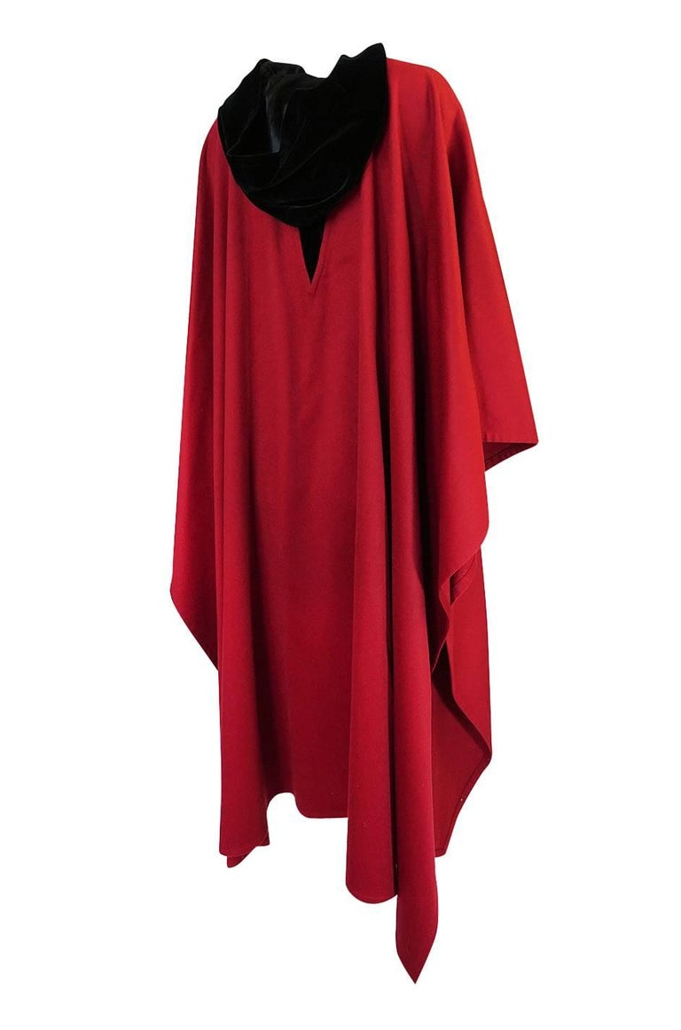 This hooded red and black cape is wonderful. It is by Yves Saint Laurent and is a beautiful and easy to wear piece that will fit virtually any size. It dates to the late 1970s, maybe to mid-1980s and is very representative of the work he was doing