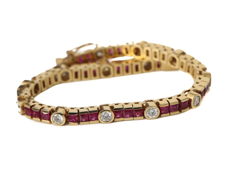 Beautiful ruby and diamond bracelet from the 1970s. All diamonds are bezel set with high contrast 18 karat yellow gold surrounding it. The ruby red stones, sparkly brilliance of diamonds and the high 18 karat gold has a beautiful color hue and