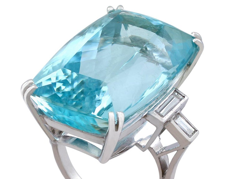 A stunning vintage 45.09 carat aquamarine and 0.96 carat diamond, 18 carat white gold cocktail ring; part of our diverse gemstone jewellery and estate jewelry collections.  This stunning, fine and impressive vintage aquamarine ring has been crafted