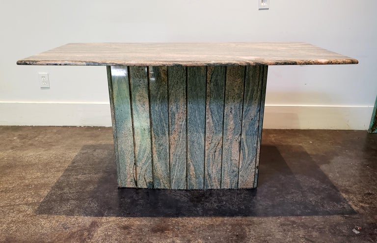 1980s Italian console table in stunning pink and grey marble. Rounded rectangular top on vertically grooved base. Both are wider at the center.   Measures: Top is 60
