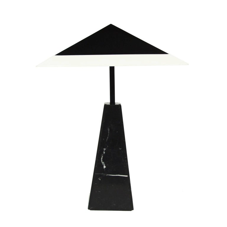 Original 1975 table lamp designed by Cini Boeri for Arteluce, Italy.  Portoro marble column with black enameled brass. White acrylic shade with a black metal diffuser.  Four bulb fittings.  Measures: H 96 cm x L 64 cm x W 64 cm.