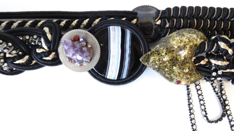 The Most Amazing Vintage Belt Is Here! Circa 1970s, this Alex & Lee macrame belt features various styles of multi-strand ropes and cords which are twisted for a unique design. Includes various decorative accents which feature details such as