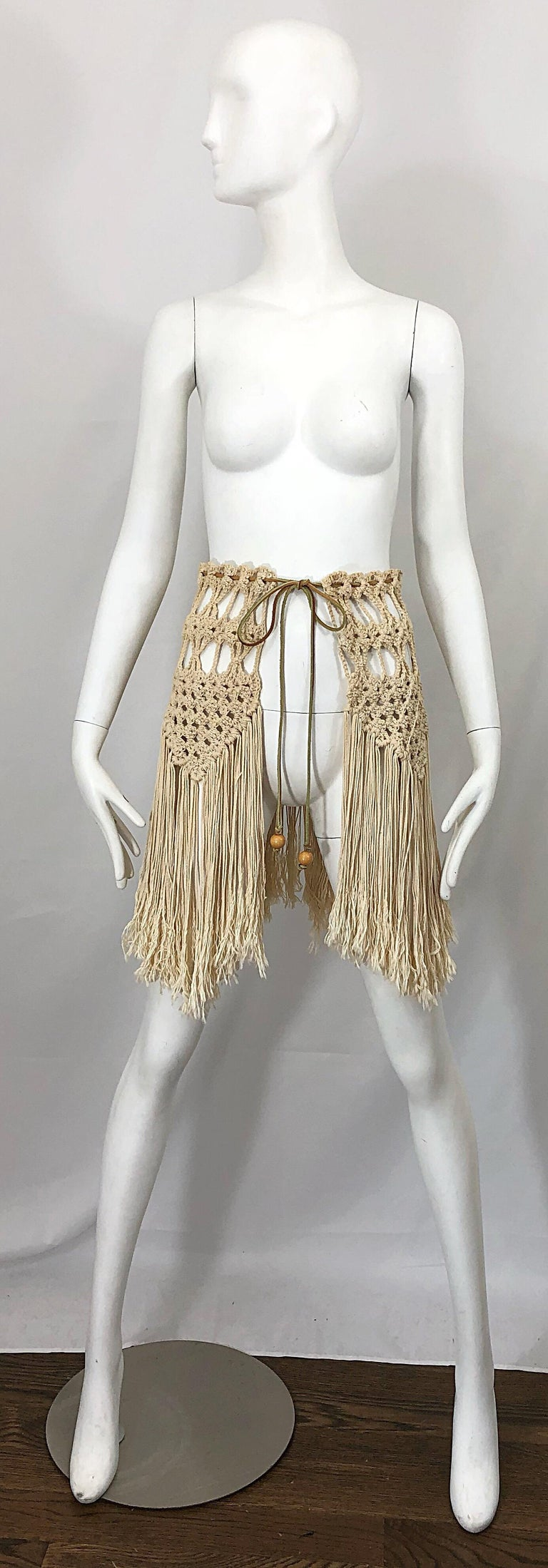 Amazing 1970s crochet khaki and brown boho crochet belt or capelet! Features fringe that dangles from the cotton crochet. Brown leather suede cord at waist with two beads at each end. Can be worn as a belt or capelet. Both ways are equally as chic.