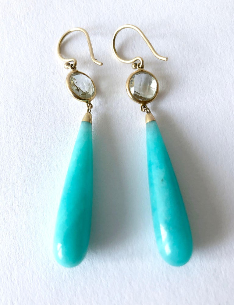Amazonite drop earrings, with faceted crystal trimmed in gold. Earrings measure 2.5