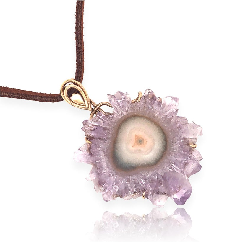 Vintage 70's gold and amethyst crystal sliced pendant. The 1 1/2