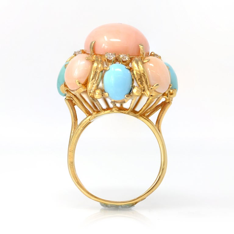 A ravishing Angel skin coral, turquoise and Diamond ring, set in 14k yellow gold circa 1970, the ring is a size 10&1/4 and would be easily sizable. This very attractive Angel skin coral and turquoise cabochon ring is an original vintage piece from