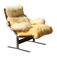 1970s Armchair in white Sheepskin and Brown Leather with Curved Steel Structure