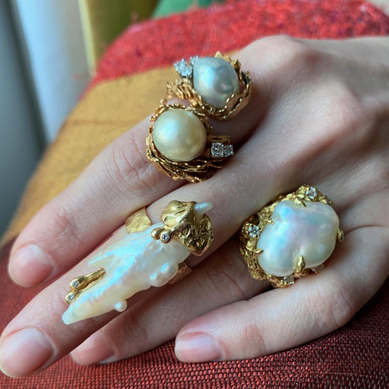A baroque south sea pearl, diamond and 18 karat gold ring, by American independent jeweler and goldsmith Arthur King, c. 1970.   The centering baroque pearl is surrounded by five full-cut diamonds. The ring measures a size 6.25 and is stamped KING,