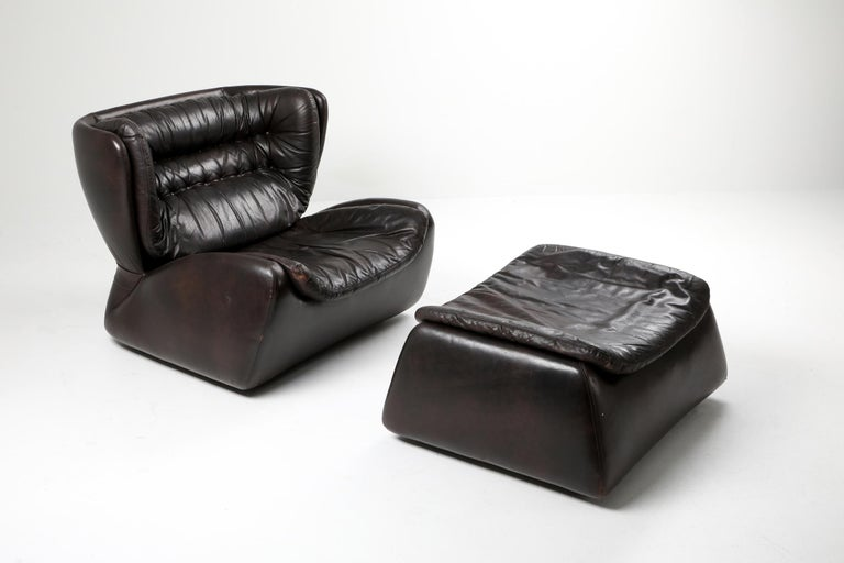 Heinz Waldmann & Anita Schmidt lounge chair and ottoman for Durlet in 1970, dark chocolate brown leather,   Durlet is a luxury leather furniture brand from Belgium, very much like De Sede in Switserland.  In the 1970s, they had a large selection