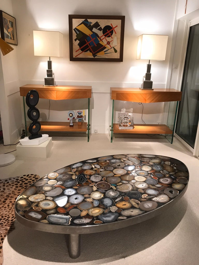 1970s coffee table with different kind of Agates inlay fixed with black resin. The table has 3 massive stainless steel feets  Great quality.