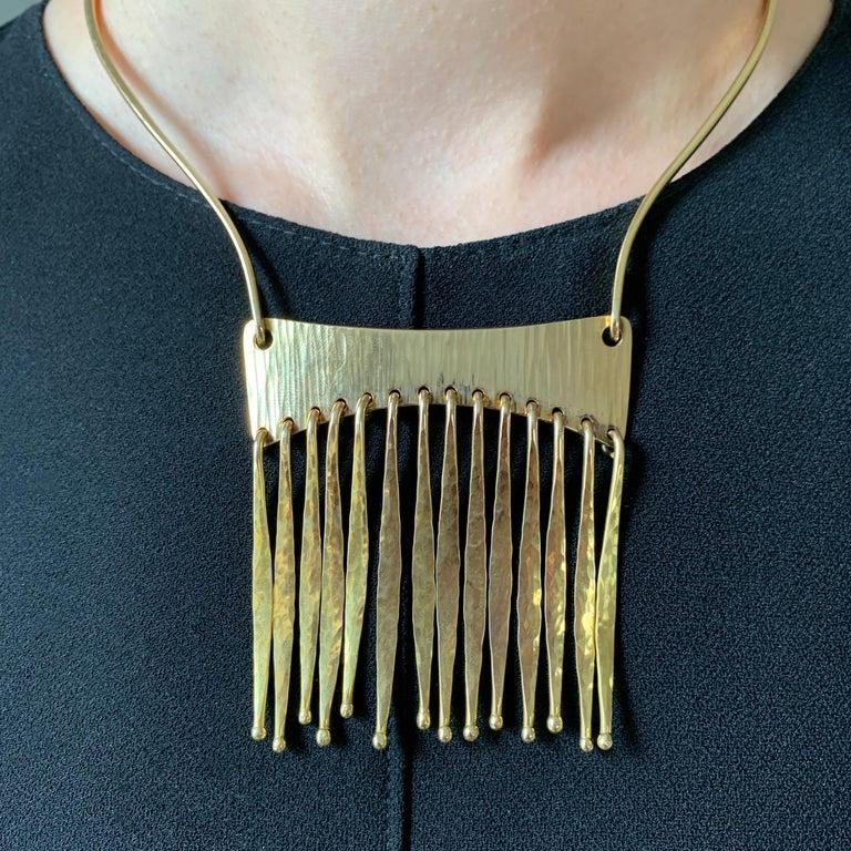 A 14 karat gold necklace, by Bent Gabrielsen, c. 1970. The necklace measures 14
