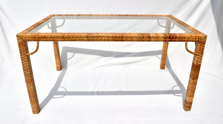 1970's Bielecky Brothers rattan & glass Parsons dining or writing table of substantial Raffia & wood construction with original removable glass top insert. Beautifully maintained over the years in rarely used condition. Nicely compliments our set of