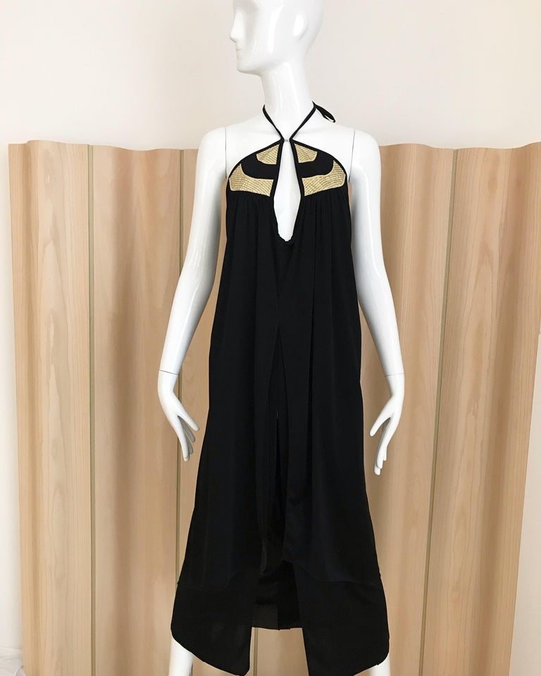 Vintage 70s Bill Tice black jersey halter dress with slit in the front. Bust: 34 inches.  Size: 2/4 Small ** label has been removed.