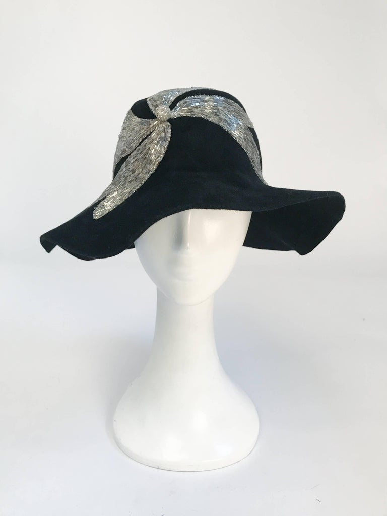 1970's Black and Silver Appliqué. Black fur felt wide brimmed hat with silver glass beaded applique. 21 1/2 inch circumference.