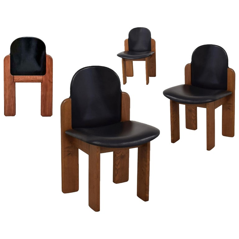 Black leather Model 330 dining chair, Silvio Coppola, Fratelli Montina, 1970s   Model 330 chair by the Italian designer Silvio Coppola. Sculptural stained beechwood frame. Original leather. Labelled. Listing is for one. Multiple available.