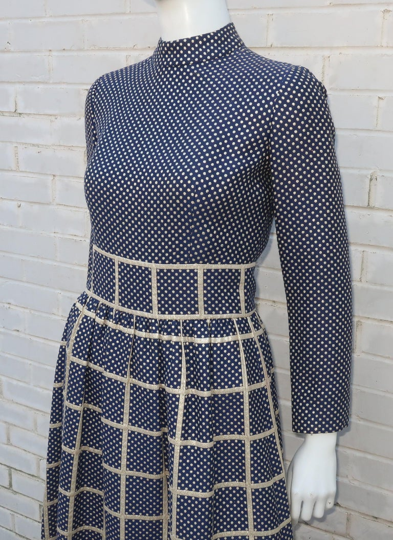 Polka dots and windowpanes make for a great combination in this 1970's maxi dress with a Dividends label.  The navy blue background is enhanced with a gold metallic print mixing the fun graphics of dots and checks.  The dress zips up the back with a