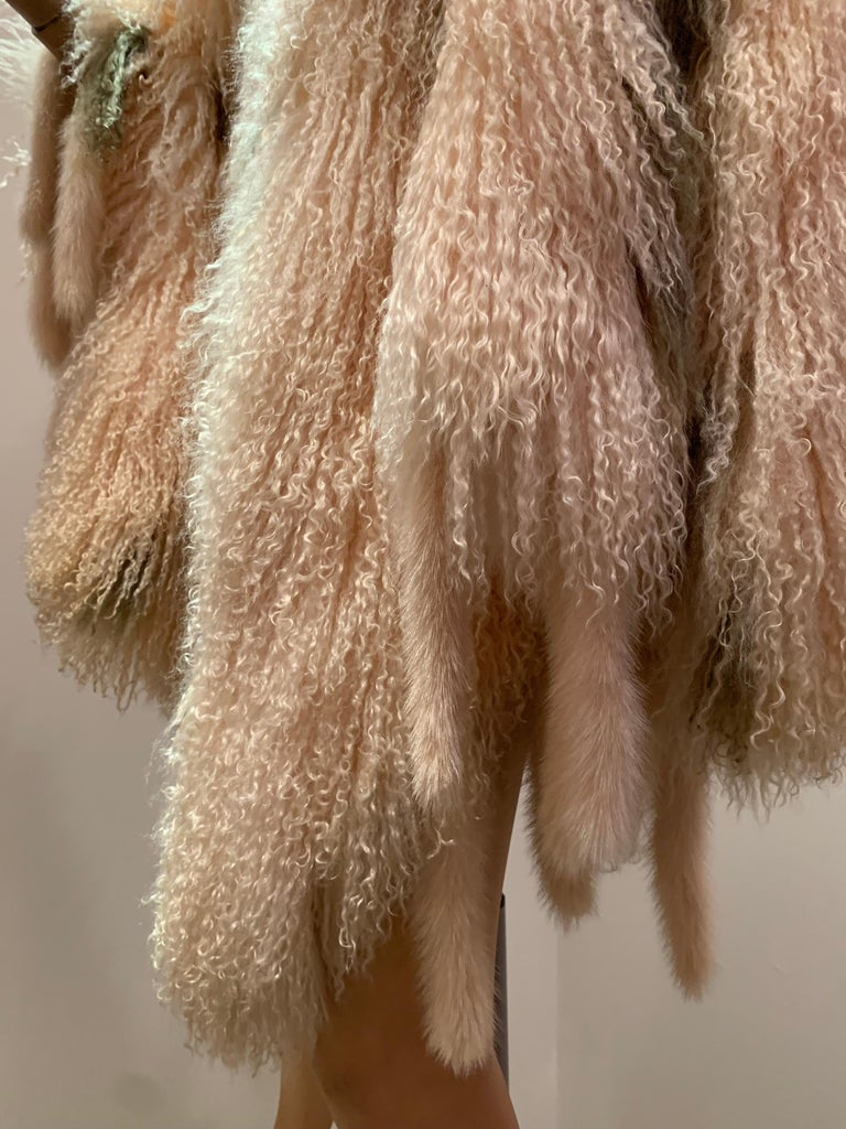 1970s Bohemian Mongolian Lamb Coat Converts To Poncho W/ Mink Tail Fringe In Excellent Condition For Sale In San Francisco, CA