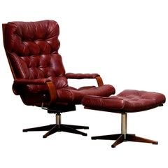 1970s, Bordeaux / Brown Rocking Swivel Lounge / Easy Chair and Ottoman by Kropp
