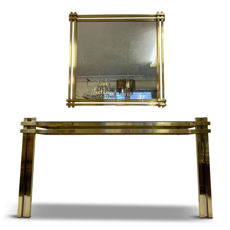 Console table and mirror  By Romeo Rega  Brass and chrome  Large mirror measures 100 x 100  1970s Italian.