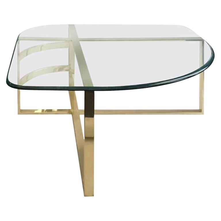 1970s Brass Coffee Table with Rounded Triangular Glass Top For Sale