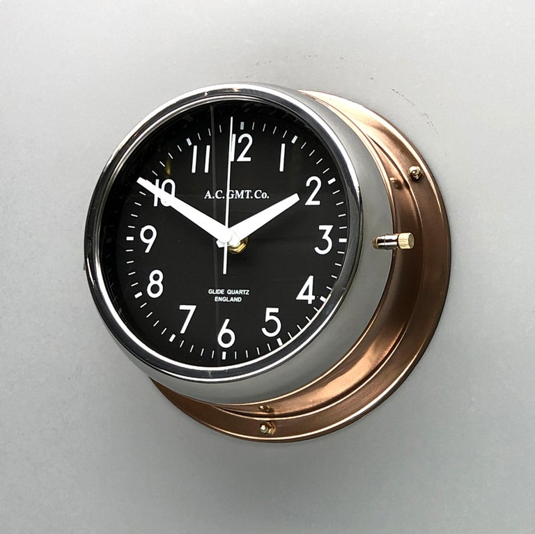 International Style 1970s British Bronze AC.GMT.Co. Industrial Wall Clock Chrome Bezel Black Dial For Sale