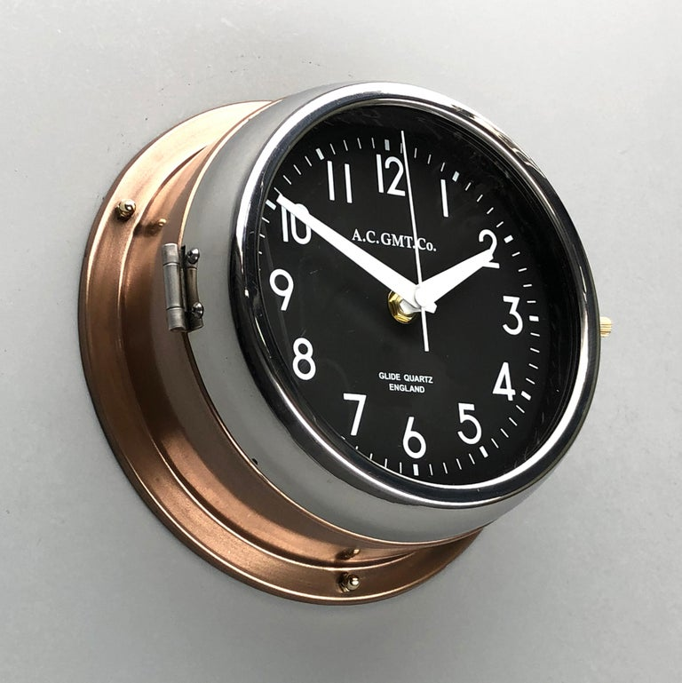 English 1970s British Bronze AC.GMT.Co. Industrial Wall Clock Chrome Bezel Black Dial For Sale