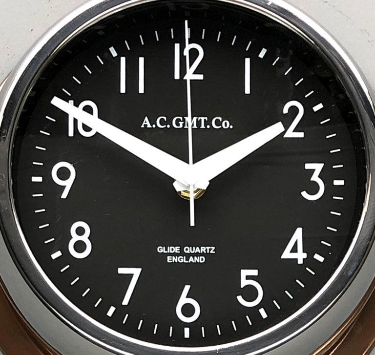 Late 20th Century 1970s British Bronze AC.GMT.Co. Industrial Wall Clock Chrome Bezel Black Dial For Sale
