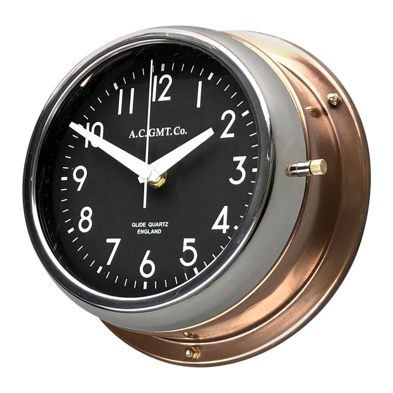 1970s British Bronze AC.GMT.Co. Industrial Wall Clock Chrome Bezel Black Dial For Sale