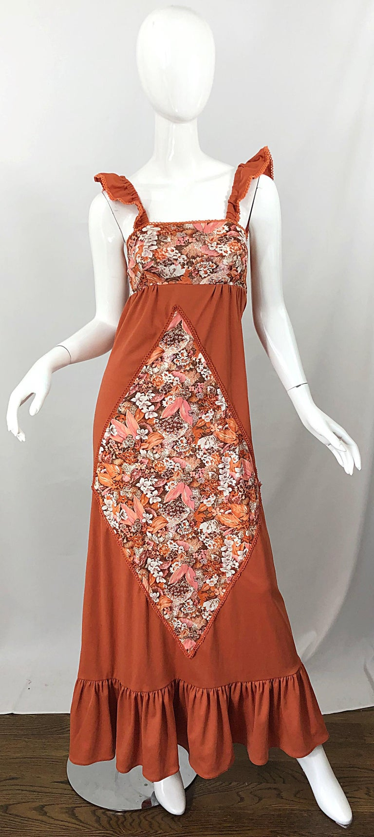 Amazing 1970s burnt orange patchwork flowers and leaves jersey maxi dress! Features a rich autumn burnt orange base color. Diamond shaped patchwork on the front with flowers and leaves printed in warm hues of pink, ivory, brown and orange. Same