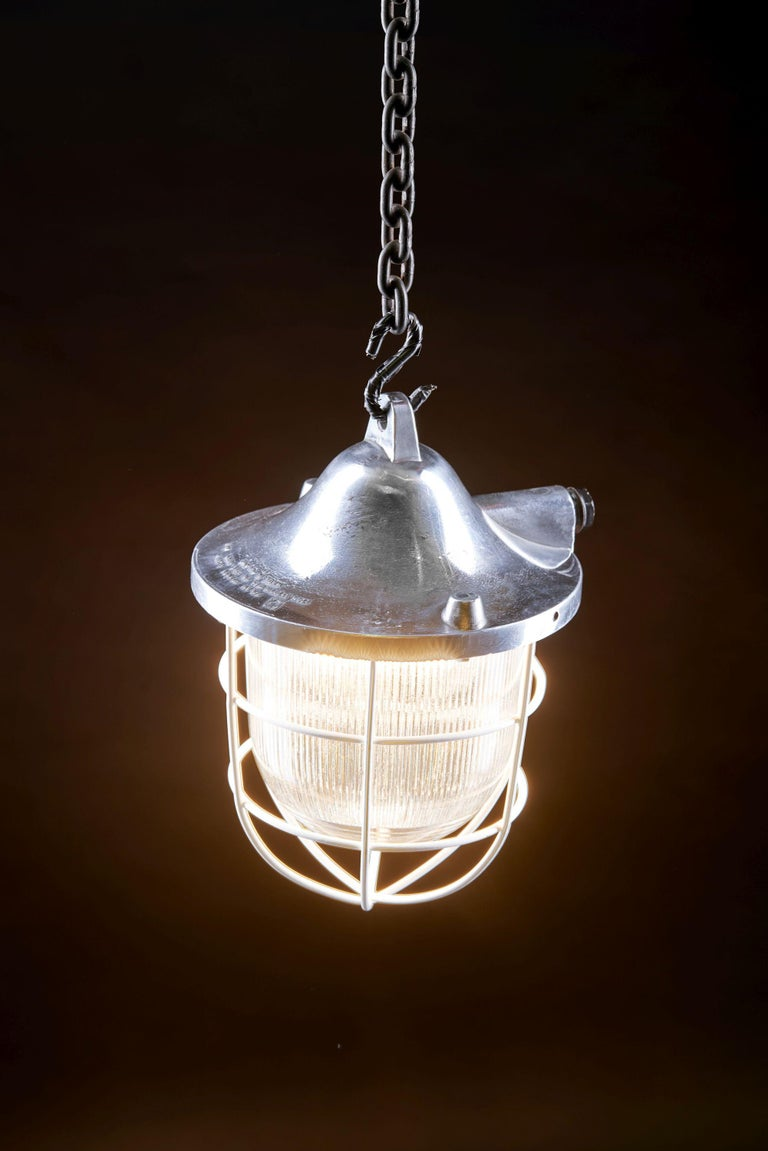 Primary use:  C-150 lamp was designed to illuminate factory premises, halls and workshops, mainly served as service and auxiliary lighting.  Manufacturer: POLAM – Gdansk Time period: 1970s  Construction:  The body is made as an aluminium