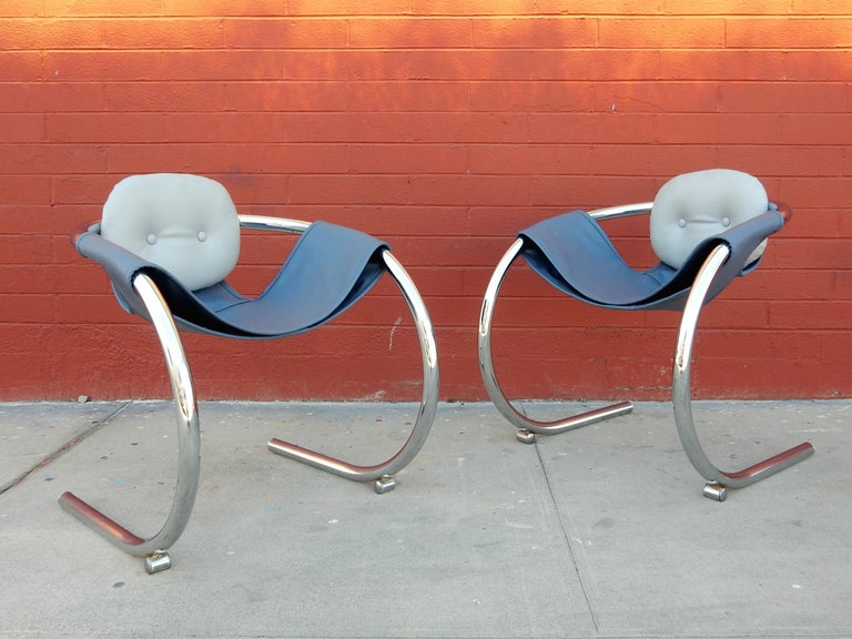 Pair of fat chrome-plated steel tube sling lounge chairs designed by Byron Botker for Landes of California. Very comfortable and super cool. New premium vinyl sling in 2-tone steel blue and silver. Solid chairs ready for use.