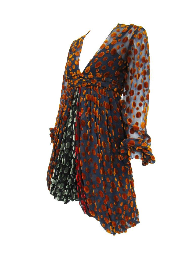 Incredibly fun romper with velvet polka dots by Cardinali! This cute romper features a slip underneath the sheer top layer with multicolored fall velvet dots. The hem  falls about mid thigh. The inside slip is a breathable silk. Loose sheer bishop
